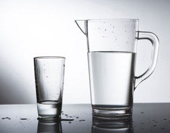 Pitcher of water with glass cup
