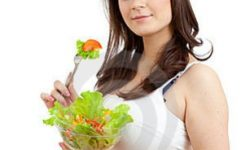 pregnant-woman-eating-healthy-food-22197872
