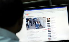 A man watches a video clip on youtube of